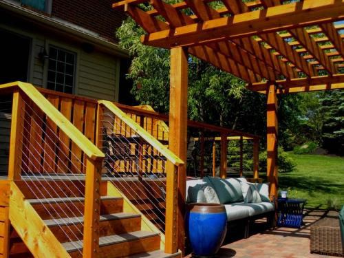 backyard arbor and deck with landscape by landscape architect