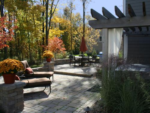 backyard patio with arbor and landscape by landscape designer